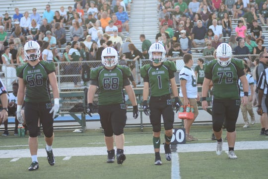 The Bulldog captains take to the field for the coin toss.