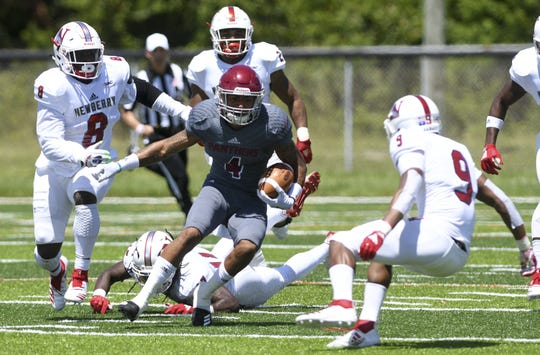 Simon Williams of Florida Tech is surrounded by Newberry defenders during Saturday's game.