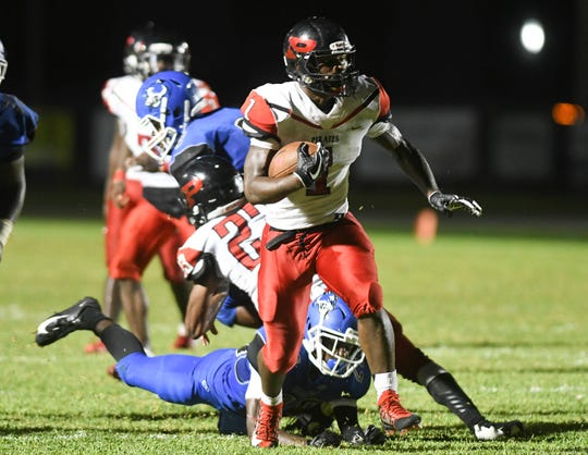 Michael Alves of Palm Bay runs the ball during Friday's game against Heritage.