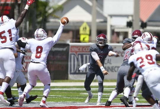 Florida Tech QB Trent Chmelik passes through the Newberry defense during Saturday's game.