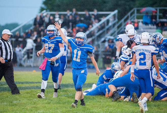 Wynford's Cody Taylor signals to the officials for possession following a fumble.