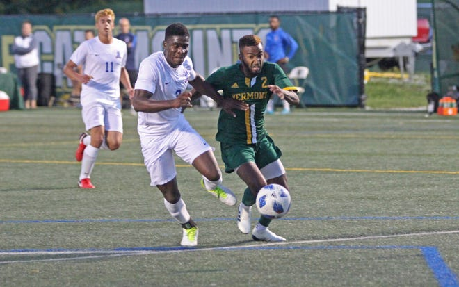 University of Vermont forward Geo Alves chases after the ball against Fairleigh Dickinson during Friday night's game at Virtue Field on Sept. 7, 2018.