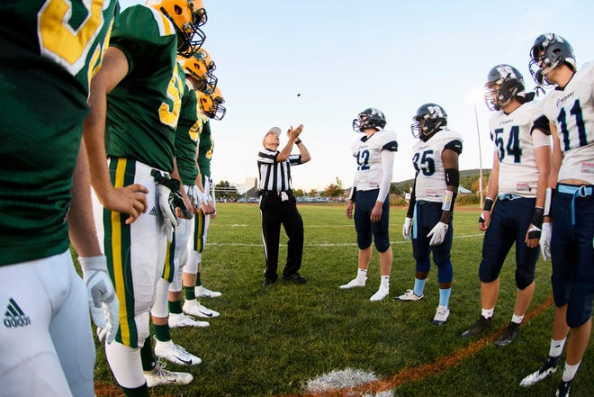 Captains from both team watch the coin flip during the football game between the Mount Mansfield Cougars and the BFA St. Albans Bobwhites at BFA High School on Friday night September 7, 2018 in St. Albans.