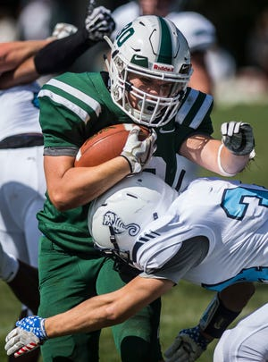 Rice #30 Joey Viner gets the full force of a tackle from Seawolves #34 Marcus Aloisi during their high school football matchup against Rice on Saturday, Sept. 8, 2018, in South Burlington. Rice won 8-6.
