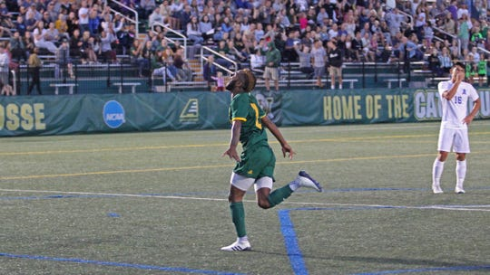University of Vermont forward Geo Alves reacts after scoring the Catamounts first goal against Fairleigh Dickinson during Friday night's game at Virtue Field on Sept. 7, 2018.