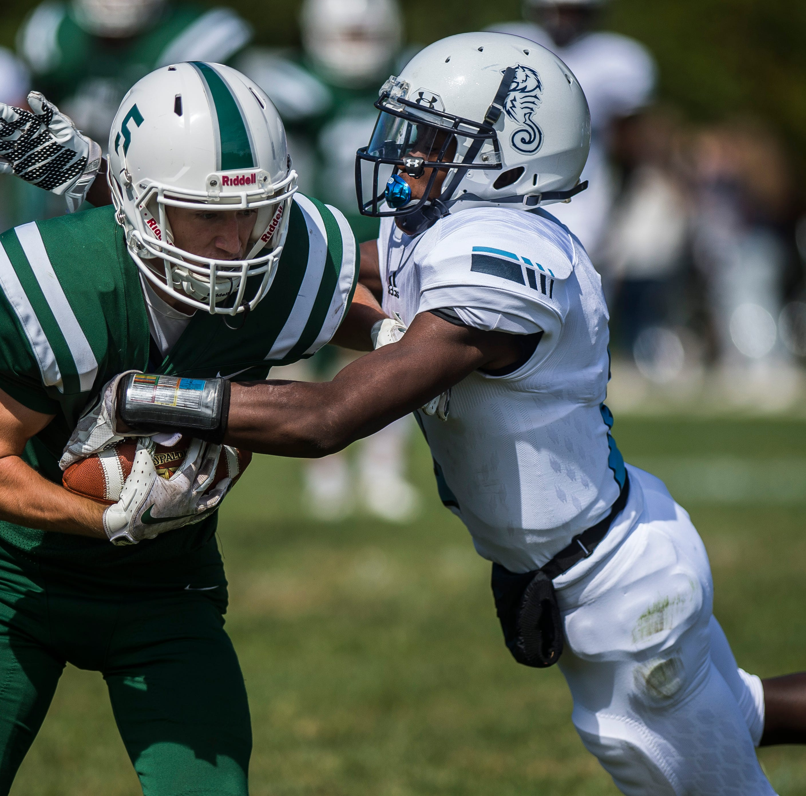 Rice #5 Andrew Snell gets caught by Seawolves #2 Bassiru Diawara during their high school football matchup against Rice on Saturday, Sept. 8, 2018, in South Burlington. Rice won 8-6.