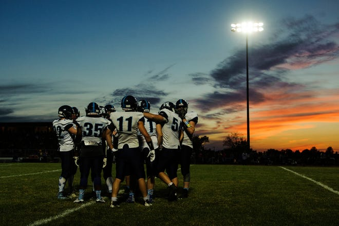 MMU huddles together during the football game between the Mount Mansfield Cougars and the BFA St. Albans Bobwhites at BFA High School on Friday night September 7, 2018 in St. Albans.