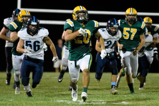 BFA's Kaleb Norris (20) runs down the field for a seventy yard touchdown during the football game between the Mount Mansfield Cougars and the BFA St. Albans Bobwhites at BFA High School on Friday night September 7, 2018 in St. Albans.