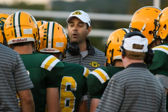 BFA head coach Geoff Murray talks to the players during the football game between the Mount Mansfield Cougars and the BFA St. Albans Bobwhites at BFA High School on Friday night September 7, 2018 in St. Albans.