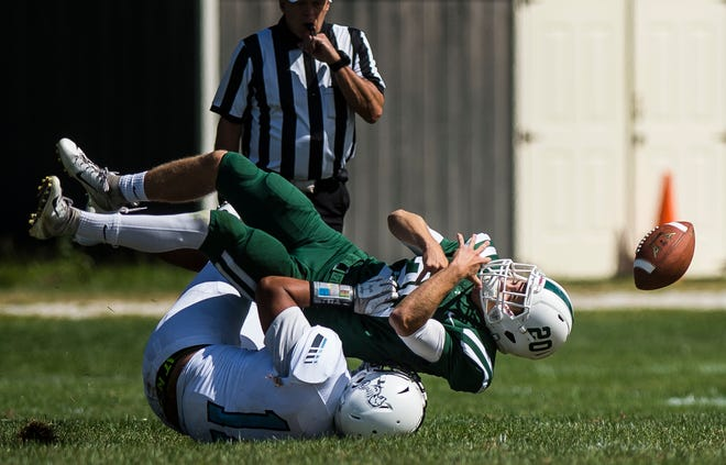 Rice #20 Ryan Byrnes is taken down by Seawolves #11 Tenzin Kelley during their high school football matchup against Rice on Saturday, Sept. 8, 2018, in South Burlington. Rice won 8-6.