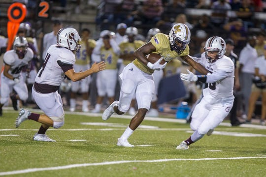 Miller Bucs' Bubba Lloyd gets past Sinton Pirates defenders during the game at Buccaneer Stadium on Friday, September 7, 2018.