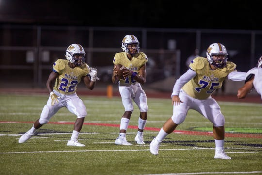 Miller Bucs quarterback Andrew Body (center) looks for an open receiver during the game against the Sinton Pirates get at Buccaneer Stadium on Friday, September 7, 2018.