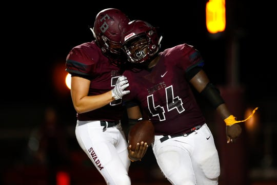 Flour Bluff's Javaris Lawson celebrates after scoring a touchdown during the second quarter of their game against  Calallen at Hornets Stadium on Friday, Sept. 7, 2018.