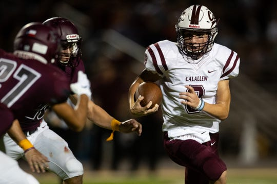 Calallen's quarterback Jarrett Garza runs the ball under presser during the second quarter of their game against Flour Bluff at Hornets Stadium on Friday, Sept. 7, 2018.