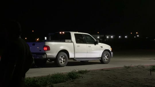 A woman in a white pickup was shot Friday evening near the Crosstown Expressway and Holly Road.
