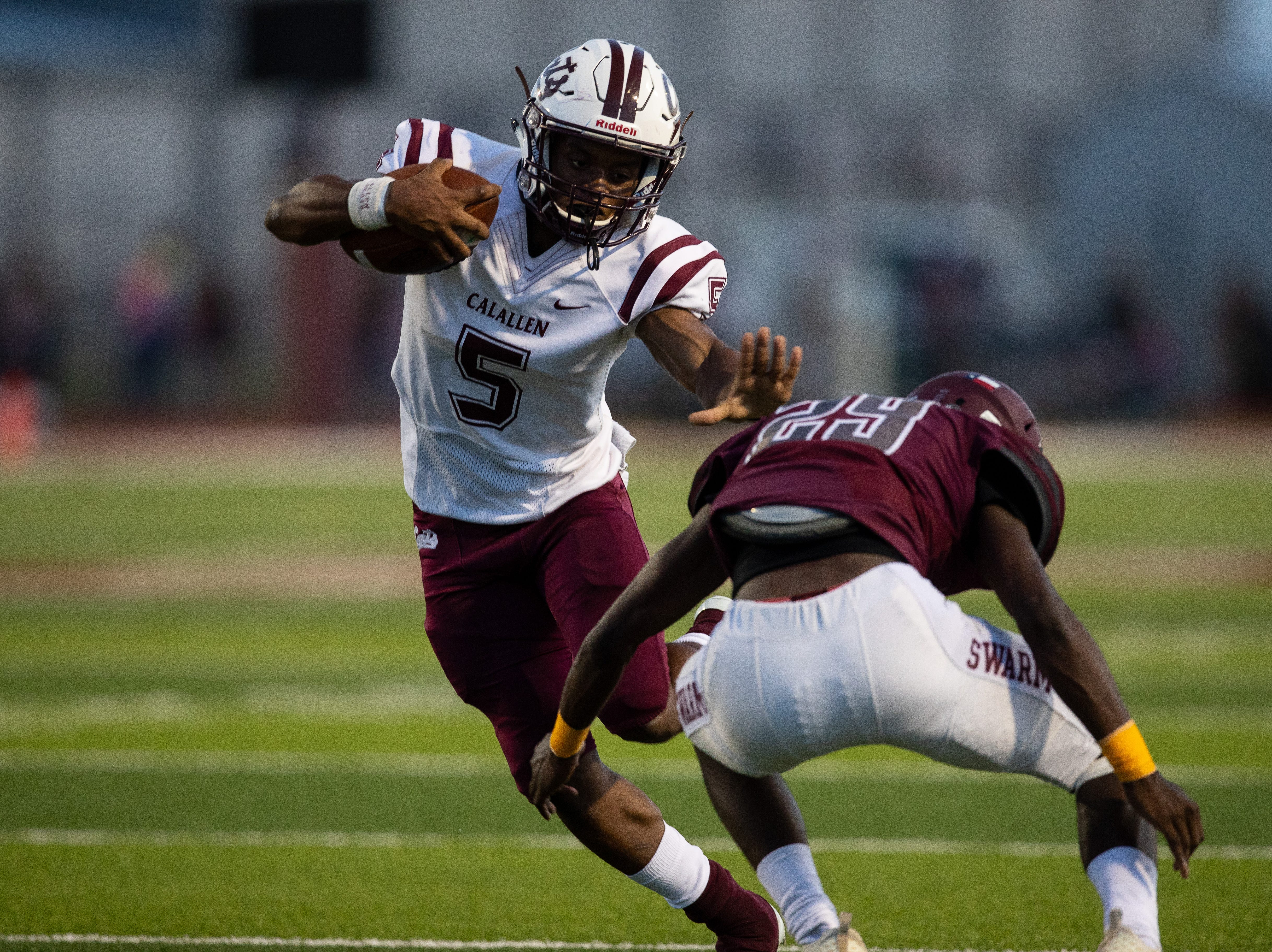 Calallen's Shenan Price runs the ball during the first quarter of their game against Flour Bluff at Hornets Stadium on Friday, Sept. 7, 2018.
