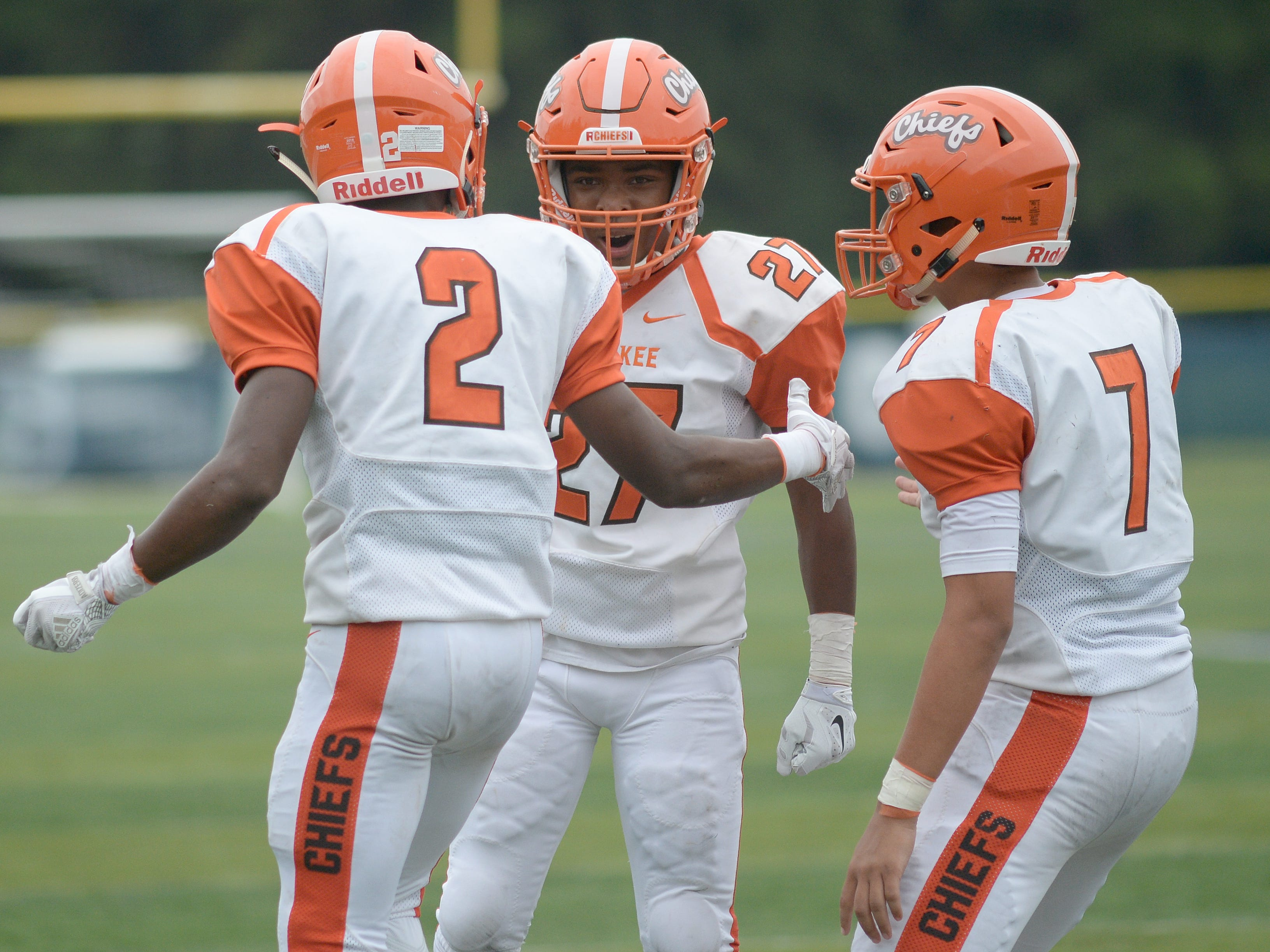 Cherokee's players celebrate with Darnell Hightower, center, after catching a touchdown pass during Saturday's football game against Shawnee at Shawnee High School,  Sept. 8, 2018.