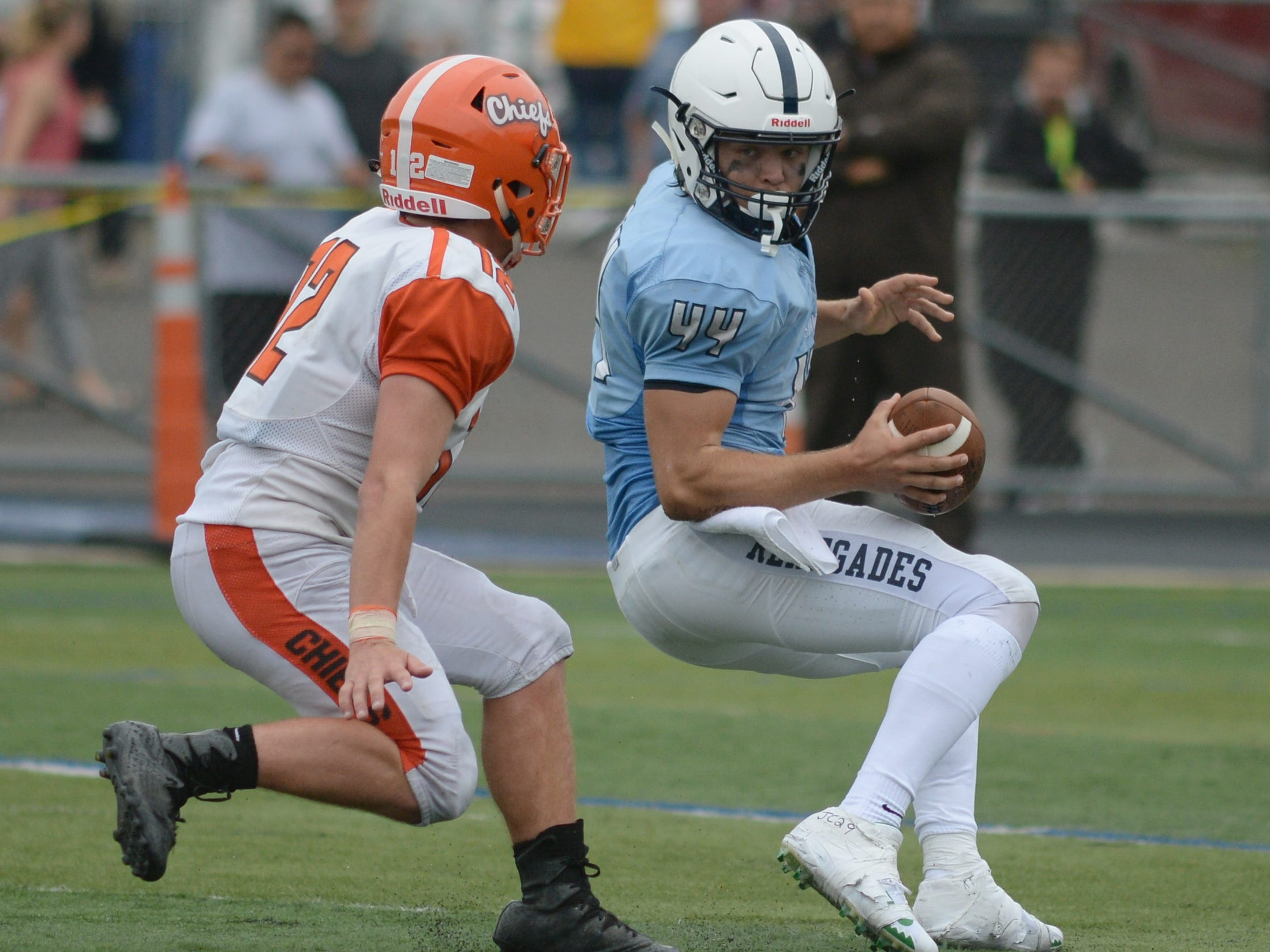 Shawnee's quarterback Joe Dalsey avoids being sacked by Cherokee's Andy Walters during Saturday's football game at Shawnee High School,  Sept. 8, 2018.