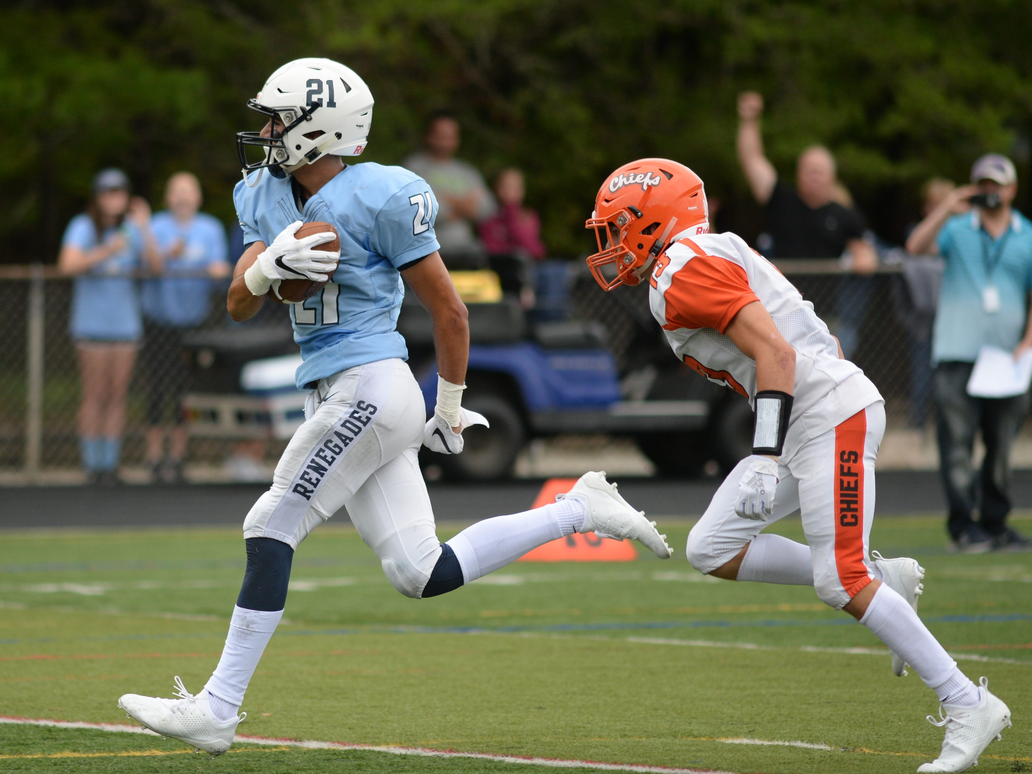 Shawnee's Jon Searcy runs for a touchdown during Saturday's football game against Cherokee at Shawnee High School,  Sept. 8, 2018.