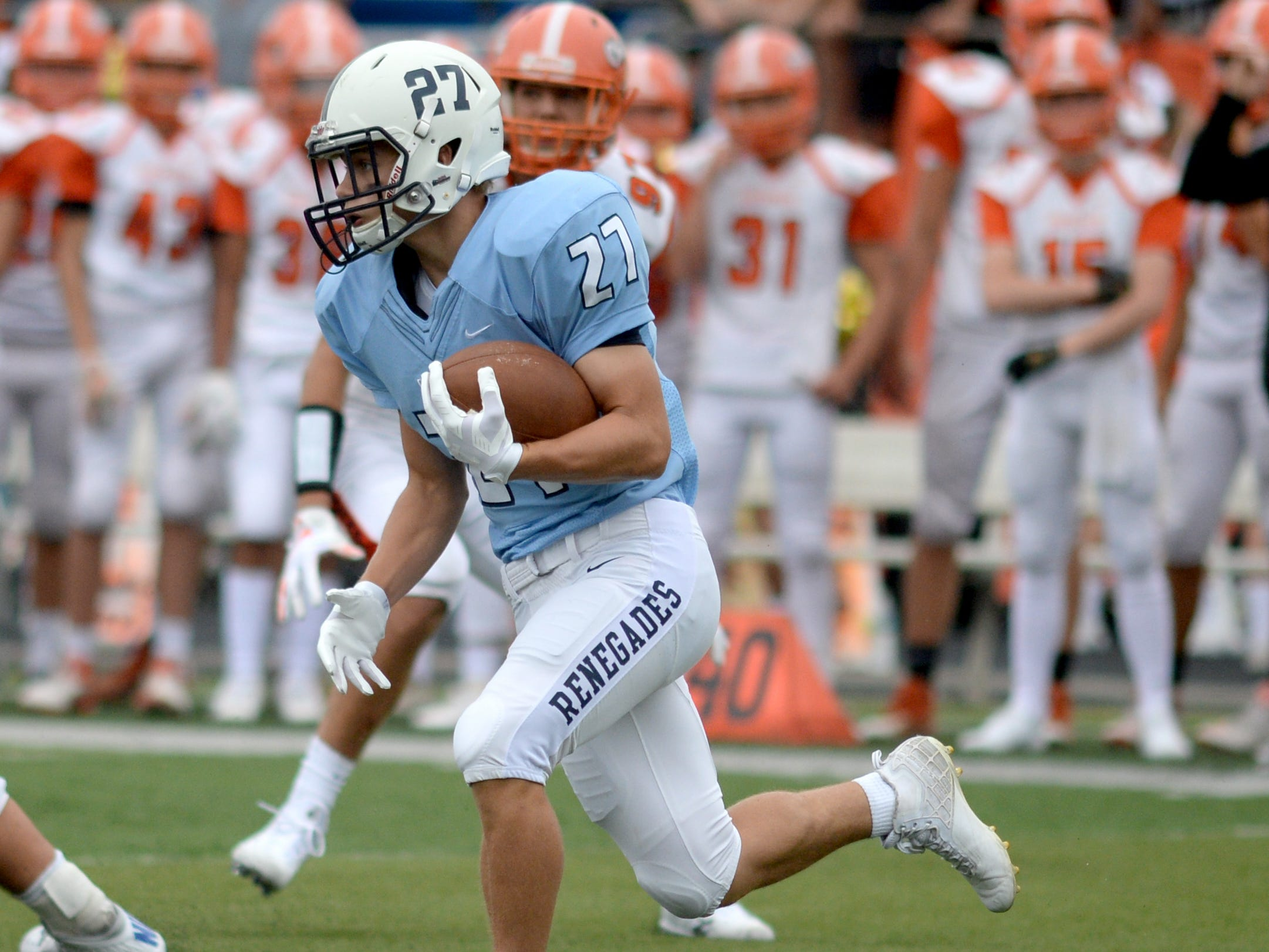 Shawnee's Tom Rebstock carries the ball during Saturday's football game against Cherokee at Shawnee High School,  Sept. 8, 2018.
