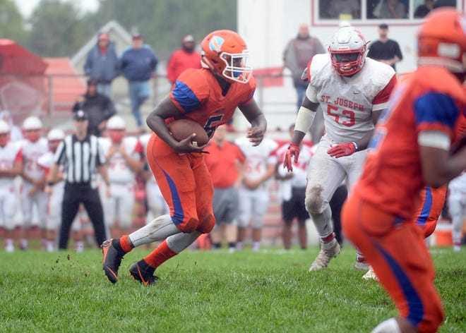 Millville running back Tex Thompson runs the ball for a short gain against St. Joseph on Saturday.