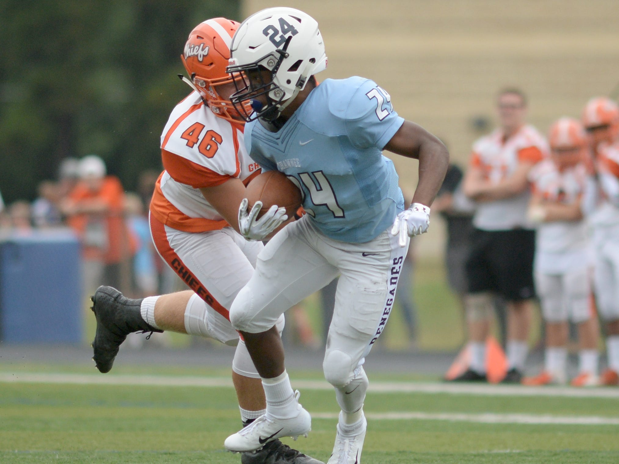 Shawnee's Kyzir Wall carries the ball during Saturday's football game against Cherokee at Shawnee High School,  Sept. 8, 2018.