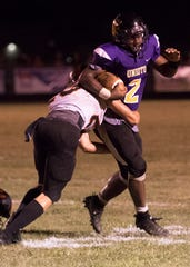Unioto's Jamarcus Carroll runs the ball in a game against Waverly in 2018. Carroll's play was making headlines for the first half of the 2018 season, then it all came to a halt when he suffered a season-ending injury against Paint Valley in week six.