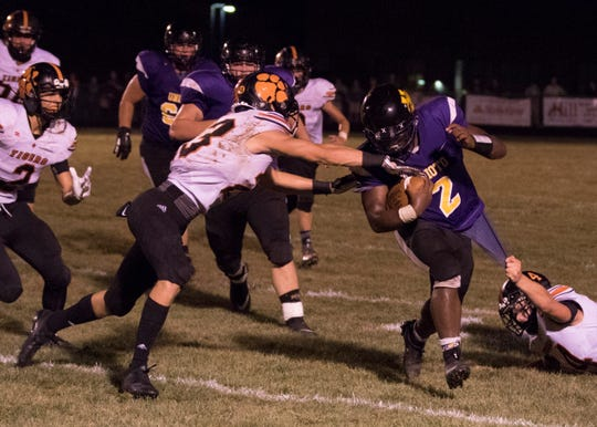 Unioto's Jarmacus Carroll drives through Waverly's defenses Friday night at Unioto High School