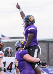 Unioto's Jamarcus Carroll celebrates with an offensive lineman in a game against Waverly in 2018. Carroll's play was making headlines for the first half of the 2018 season, then it all came to a halt when he suffered a season-ending injury against Paint Valley in week six.