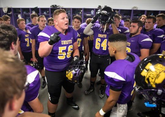 Unioto lineman Dalton Ford (56) looks to pump up teammates before going to play Waverly at Waverly High School last season.