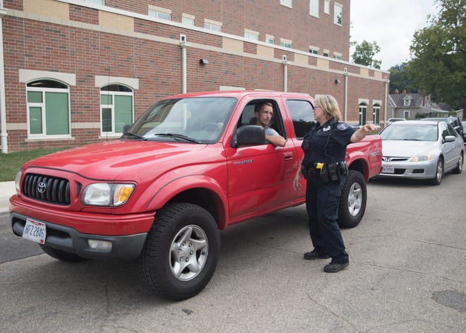 Office Murray explains to a parent where they can park to pick up their kids at the new Chillicothe Primary School Friday morning.