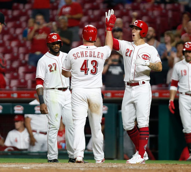Sep 7, 2018; Cincinnati, OH, USA; Cincinnati Reds right fielder Scott Schebler (43) is congratulated by left fielder Phillip Ervin (27) and relief pitcher Michael Lorenzen (21) after Schebler hit a grand slam against the San Diego Padres in the sixth inning at Great American Ball Park. Mandatory Credit: David Kohl-USA TODAY Sports