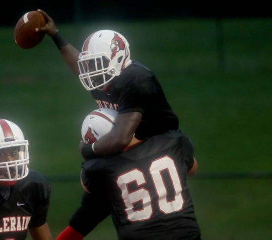 Colerain's Deante Smith-Moore celebrates after scoring a touchdown during the Cardinals' football game against Princeton, Friday, Sept. 7, 2018.