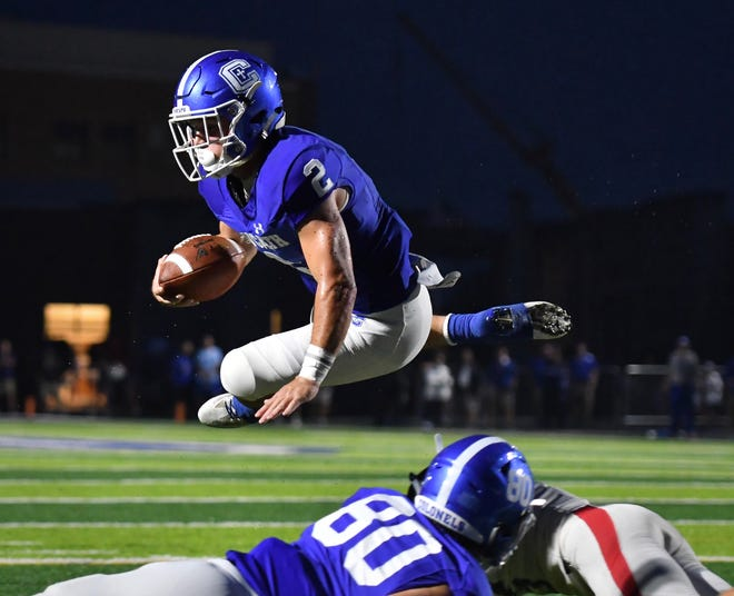 Covington Catholic's Casey McGinness dives for the end zone against Kings  Friday, Sept. 7, 2018 at Covington Catholic High School