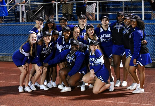 The Wyoming Cheerleaders take a time out for a pose and pic during the Cowboys win over CHCA, Sept. 7, 2018.
