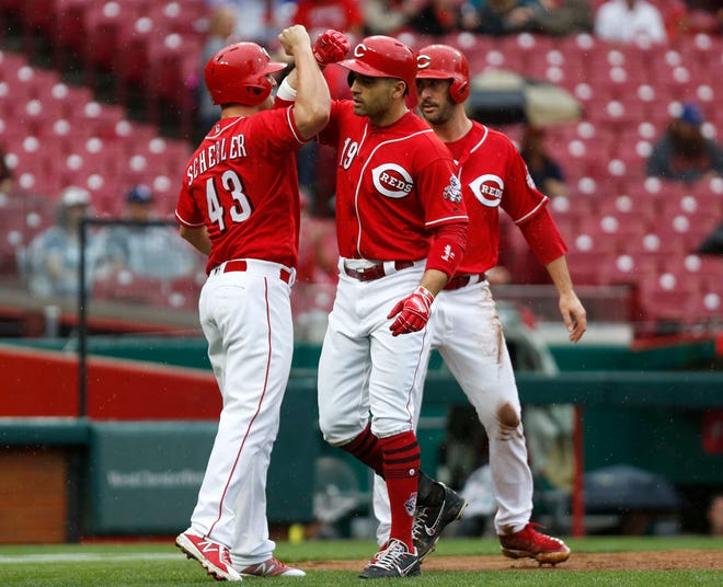 Sep 8, 2018; Cincinnati, OH, USA; Cincinnati Reds first baseman Joey Votto (19) celebrates with right fielder Scott Schebler (43) and starting pitcher Matt Harvey (32) after hitting a grand slam against the San Diego Padres during the second inning at Great American Ball Park. Mandatory Credit: David Kohl-USA TODAY Sports
