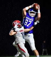 Covington Catholic's Michael Mayer leaps for a deep pass against Kings Friday, Sept. 7, 2018 at Covington Catholic High School