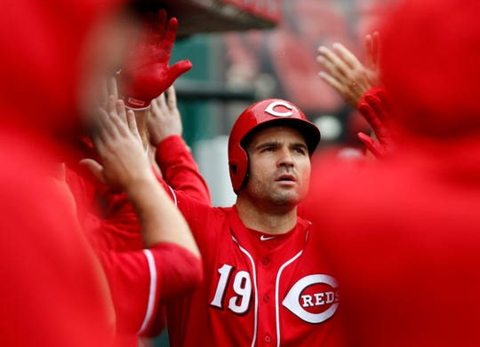 Sep 8, 2018; Cincinnati, OH, USA; Cincinnati Reds first baseman Joey Votto (19) is congratulated in the dugout after hitting a grand slam against the San Diego Padres during the second inning at Great American Ball Park. Mandatory Credit: David Kohl-USA TODAY Sports