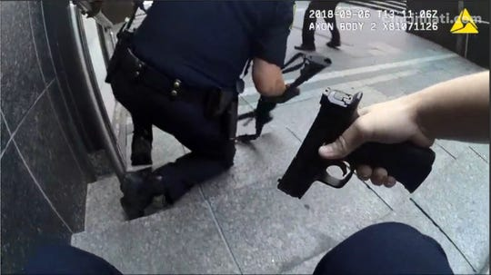A screen grab from a Cincinnati Police officer's body cam during the response to the active shooter Thursday morning at Fifth Third Center in Fountain Square.