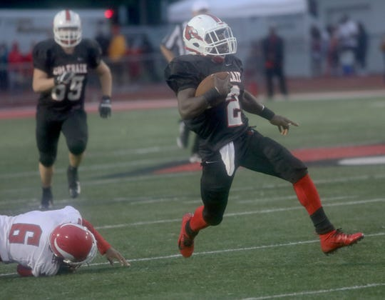 Colerain's Deante Smith-Moore runs for a touchdown during the Cardinals' football game against Princeton, Friday, Sept. 7, 2018.