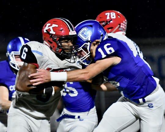 Kings' Nak'emon Williams is stuffed in the backfield by Covington Catholic's Luke Summe Friday, Sept. 7, 2018 at Covington Catholic High School