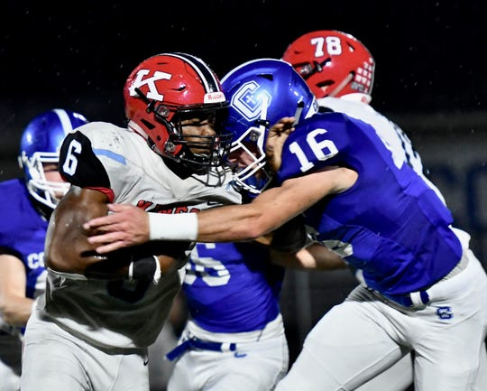 Kings' Nak'emon Williams is stuffed in the backfield by Covington Catholic's Luke Summe Friday, Sept. 7, 2018 at Covington Catholic High School