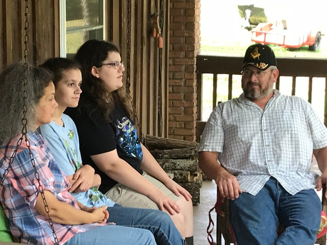 The Hayes family sits on the porch they say is no longer so peaceful. Michael Hayes says his family is already disturbed by the sound of firearms at a nearby shooting range, and are new concerned about Cross Creek Clays' plans to add an event space.