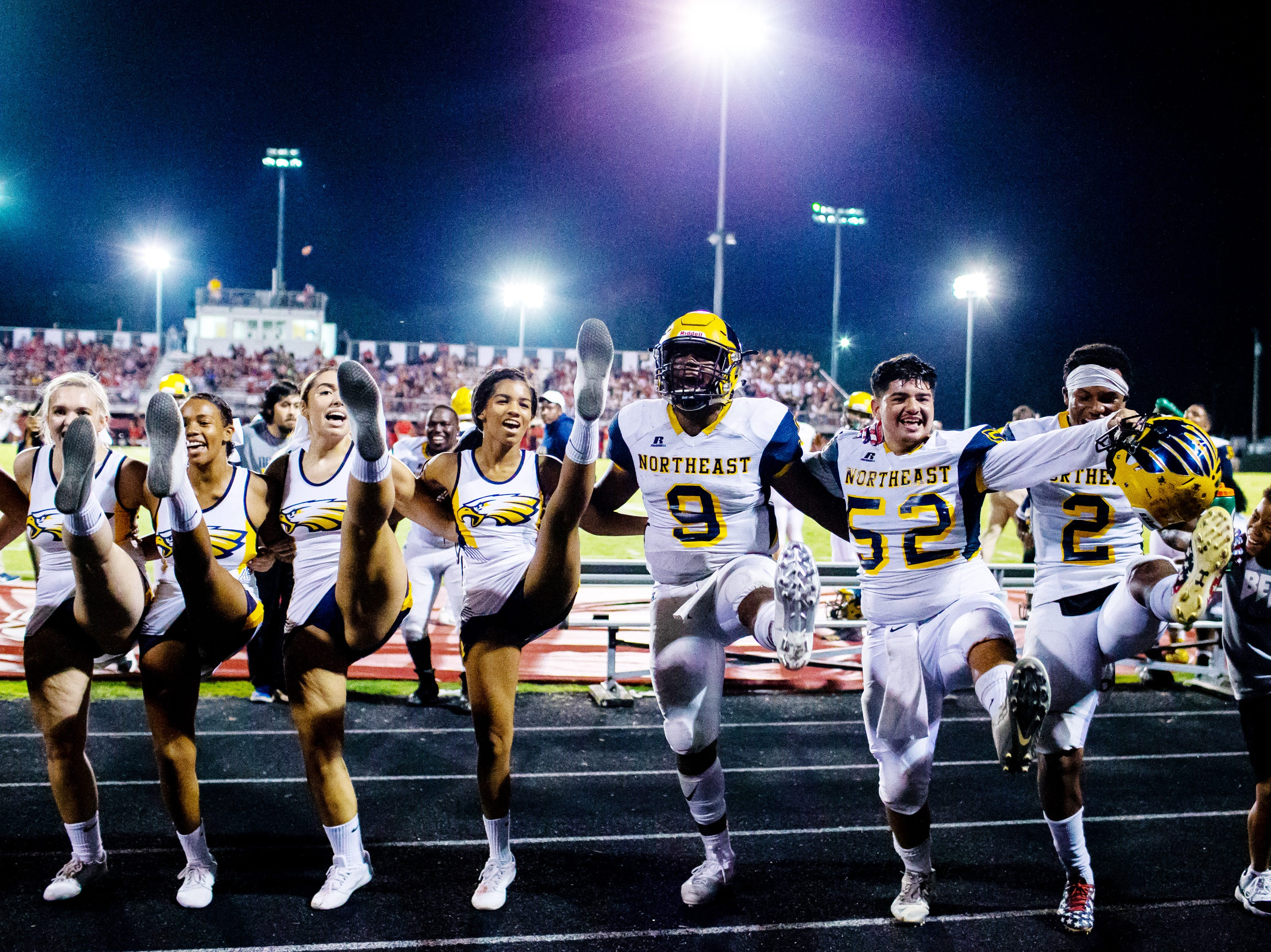 Northeast players join cheerleaders in the kick line after their touchdown during the second half at Rossview Friday, Sept. 7, 2018, in Clarksville, Tenn.