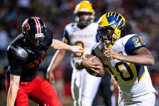 Tyrique Freeman (20) of Northeast runs the ball during the second half at Rossview Friday, Sept. 7, 2018, in Clarksville, Tenn.