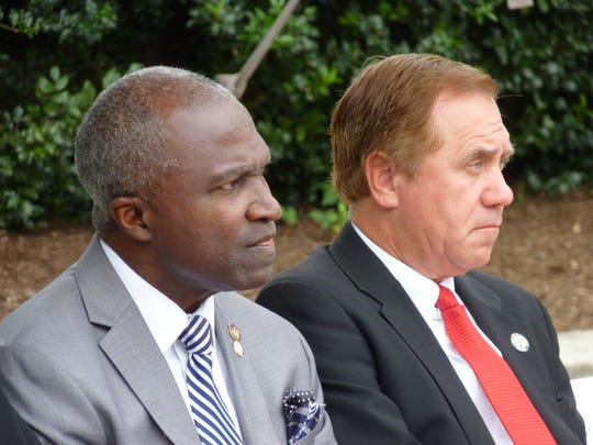 Plainfield Mayor Adrian Mapp, left, and Assembly Speaker Craig Coughlin at the dedication of the Assemblyman Gerald B. Green Plaza at the former Park-Madison Building in Plainfield.