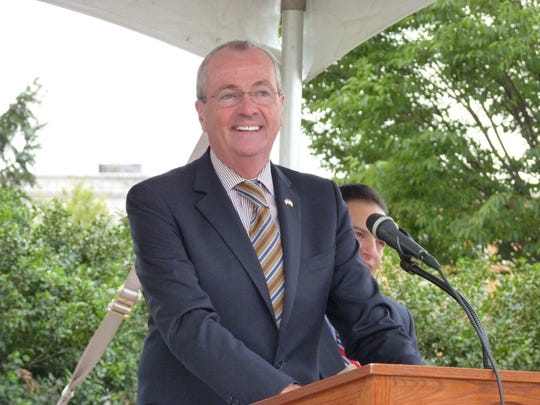 Gov. Phil Murphy at the dedication of the Assemblyman Gerald B. Green Plaza at the former Park-Madison Building in Plainfield.