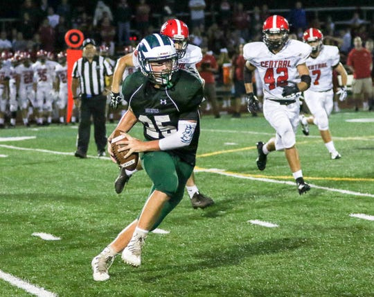 Jake Hoffman of Ridge looks for room after catching a pass against Hunterdon Central in Basking Ridge on September 7, 2018. (Photo by Keith Muccilli, Correspondent)