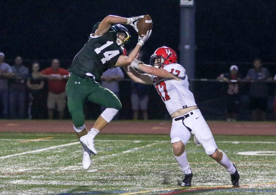Nolan Haddad of Ridge, left, catches a pass over Hunterdon Central defender Benjamin Kenyon in Bernards Township on September 7, 2018. (Photo by Keith Muccilli, Correspondent)