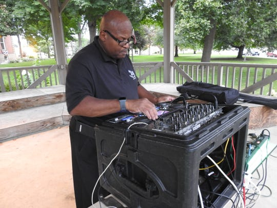 Reggie Robinson tests sound equipment at a National Recovery Month Event on the Coshocton Court Square held by Coshocton Behavioral Health Choices.